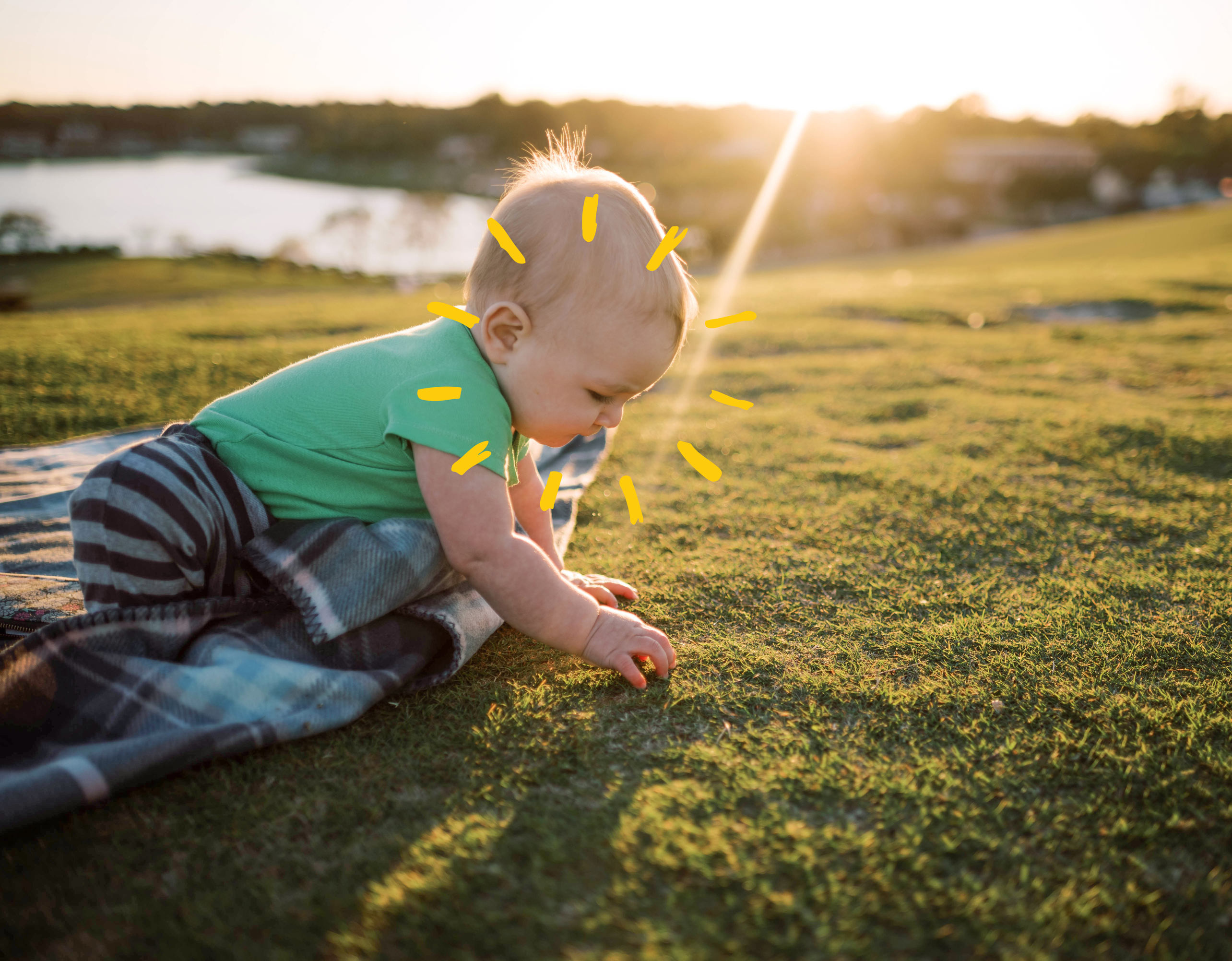 cute baby is playing in the grass